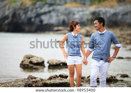 Romantic young couple at sea