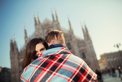 Romantic young couple embracing in front of the Duomo, Italy