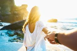 Romantic young couple enjoying sun, beach and water near sea. Romance and love on the sand. Summer season on beach