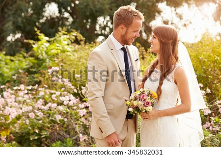 Romantic Young Couple Getting Married Outdoors
