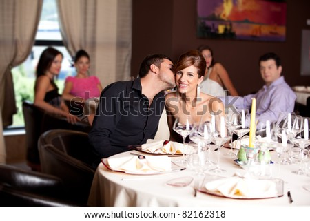 romantic young couple in restaurant date kiss