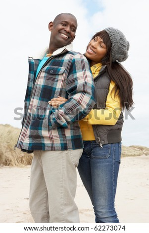 Romantic Young Couple On Winter Beach - stock photo