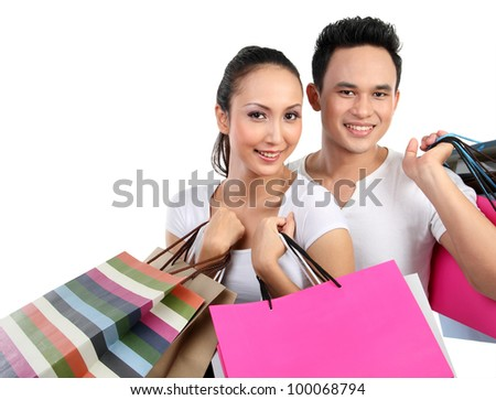 Romantic young couple shopping and holding many shopping bags