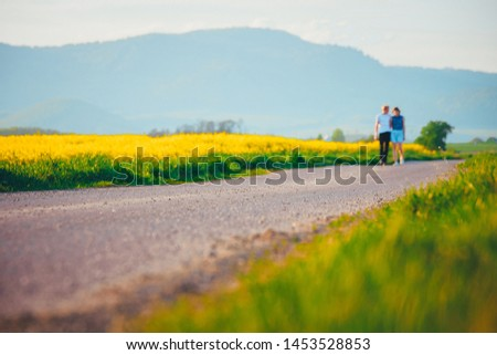 Romantic young couple walking on the road, white edit space #1453528853