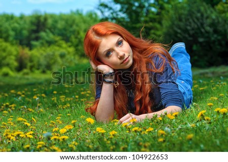 Romantic young woman  outdoors at a summer day.