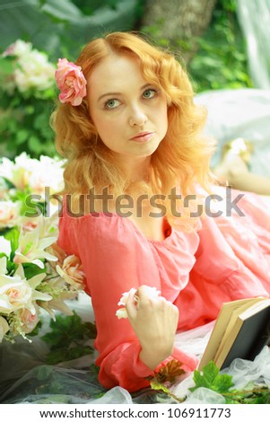 Romantic young woman outdoors at a summer day. Focus on eyes and face. Soft summer colors.