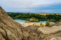 Romantsevskie mountains in the Tula region, Russia.Unique natural location reminiscent of the surface of Mars.Amazing alien landscape, coal mine.Konduki.  Sandy-brown rocks.Blue and emerald lakes