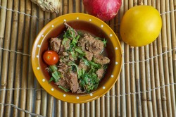 Romazava - national dish of Madagascar, consisting of greens, zebu meat, tomatoes, and onions, combination of green leafy vegetables