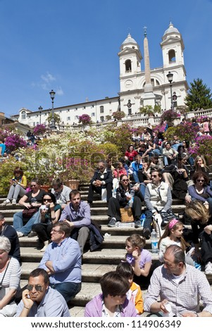 ROME - APRIL 25: People sitting on the Spanish Steps and enjoying the sun on April 25, 2012 in Rome, Italy. The Spanish Steps are one of the main tourists sights in Rome and can become very crowded.