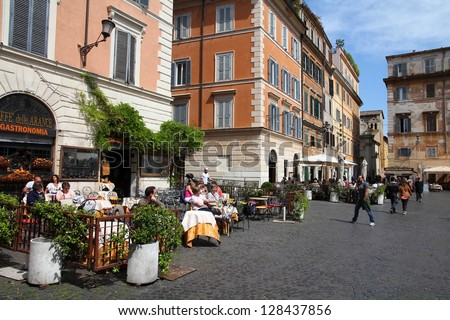 ROME - APRIL 10: People visit old district Trastevere on April 10, 2012 in Rome. According to Euromonitor, Rome is the 3rd most visited city in Europe (5.5m international tourist arrivals 2009)