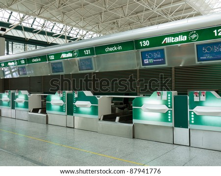 ROME - CIRCA SEPTEMBER 2011: Alitalia check-in desks at Fiumicino airport, circa September 2011, Rome. In 2010 Alitalia, Italy's biggest and the world's 19th airline had 23,4 million passengers.
