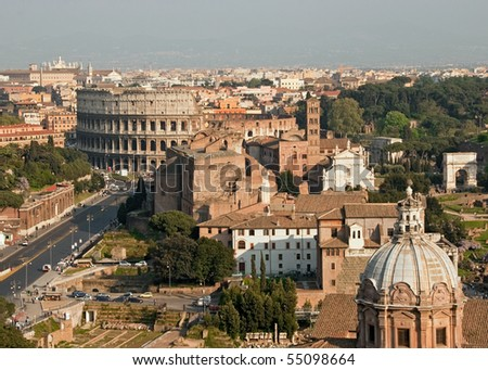 Rome cityscape seen with Coliseum, Roman Forum and San Pietro in carcere Church.