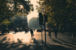 Rome in early morning. Street view. People crossing the street. Retro tinted photo
