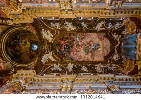 Rome in Italy in a church. the picture shows the ornate ceiling. well known is the church from the movie Davinci Code