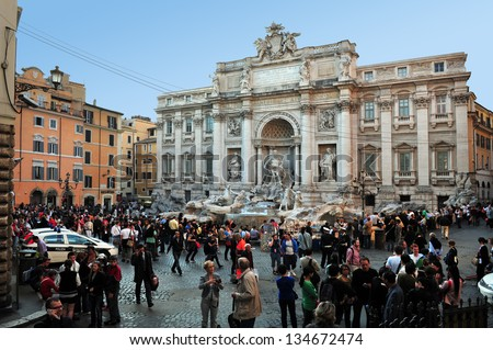 ROME, ITALY - APRIL 28: Visitors at Trevi Fountain on April 28 2011 in Rome, Italy.The Trevi Fountain is 26 mt high and 20 mt wide, it is one of the most famous fountains in the world.