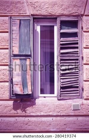 Rome, Italy - architectural feature in Trastevere district, old window. Cross processed color style - retro image filtered tone.