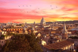 Rome, Italy at sunset. Cityscape with amazing pastel colours sky and nice view of the city with church basilicas domes.