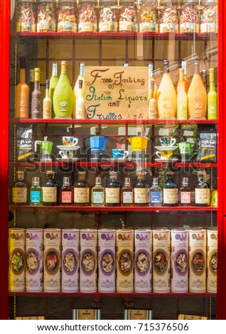ROME, ITALY - AUGUST 28, 2017 - Shop window with free taste of Italian liquors, truffles and pasta in the Trastevere area.  #715376506