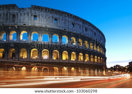 Rome - Italy. Coliseum at night with colorful blurred traffic lights.