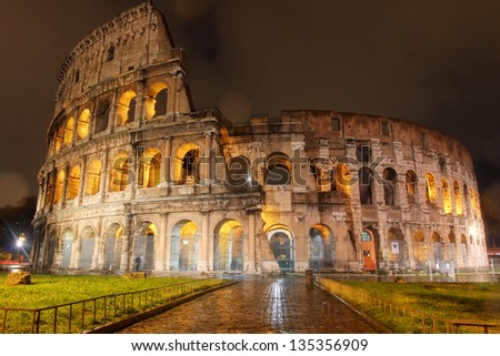 ROME, ITALY - DEC 10: Ancient Roman Colosseum at night, The largest amphitheatre in the world, is an elliptical amphitheatre in the centre of Rome, Italy on Dec 10, 2012.