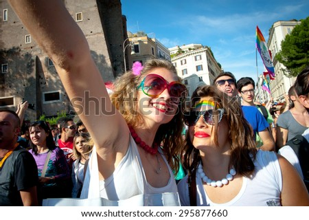 ROME, ITALY - JUNE 11 2011. Euro gay pride day, parade people on city streets during the demonstration. Couple portrait #295877660
