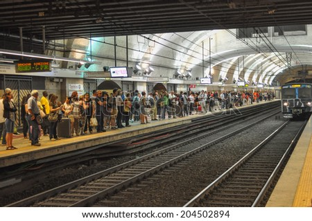 ROME, ITALY - JUNE 24, 2014: People waiting for a train at Termini subway station