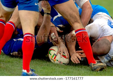 ROME, ITALY-MARCH 27, 2007: Rugby players scrum during the Six Nations Tournament match Italy vs France.