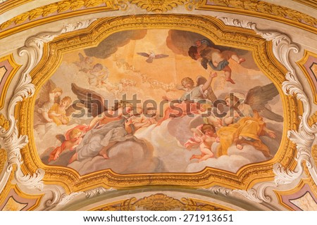 ROME, ITALY - MARCH 26, 2015: The ceiling fresco of Angels with the Holy Spirit  from begin of 17. cent. in church Chiesa di Santa Maria in Transpontina and chapel of Pieta.