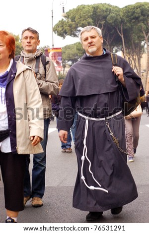 ROME, ITALY - MAY 1: A monk is marching among the people attending the beatification of Pope John Paul II in Rome, Italy on May 1, 2011.