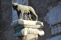 Rome / Italy - May 29, 2009: Ancient roman bronze statue of a she-wolf feeding Romulus and Remus the traditional founders of the city and empire of Rome, Italy