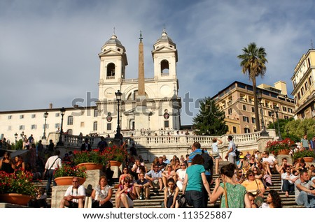 ROME, ITALY - MAY 31: Spanish steps in Rome, Italy on May 31, 2012. The monumental stairway of 138 steps was designed by architects Francesco de Sanctis and Alessandro Specchi in 1723-Â?Â?1725
