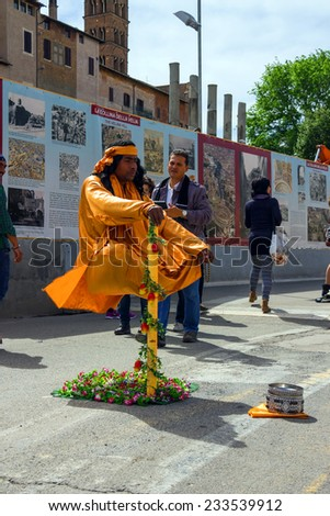 ROME, ITALY - MAY 04, 2014: Street performer in clothing monk demonstrates  trick of levitation in Rome, Italy