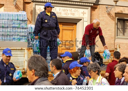 ROME, ITALY - MAY 1: Volunteers hand out bottled water to people attending the beatification of Pope John Paul II in Rome, Italy on May 1, 2011.