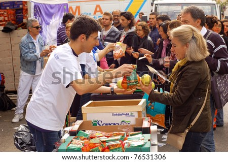 ROME, ITALY - MAY 1: Volunteers hand out snacks to people attending the beatification of Pope John Paul II in Rome, Italy on May 1, 2011.