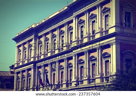 Rome, Italy. Ministry of Agriculture and Forestry - governmental building. Cross processed color style - retro image filtered tone.