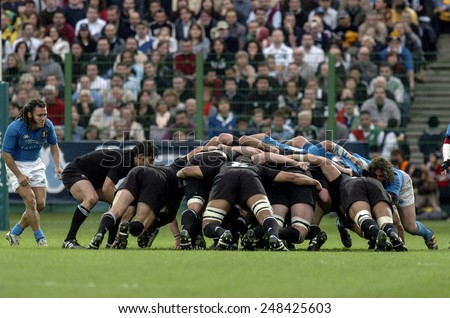 ROME, ITALY-NOVEMBER 13, 2004: all blacks rugby players scrum in action during the rugby test match Italy vs New Zealand, in Rome.