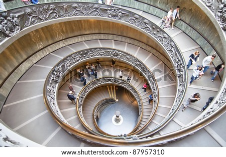 ROME, ITALY-OCTOBER 17: Unidentified people down the spiral staircase of Vatican Museums on October 17, 2011 in Rome,Italia.  These stairs were designed by Giuseppe Momo in 1932