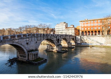 ROME, ITALY, on March 11, 2017. View of Tiber and its embankments. Ponte Sisto - the pedestrian bridge connecting the right coast of Tiber and the Region of Trastevere #1142443976