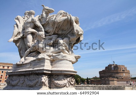 Rome, Italy. One of the statues at famous Ponte Vittorio Emanuele 2. Castell Sant' Angelo in the background. - stock photo