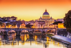 Rome, Italy. San Pietro Basilica and Ponte St Angelo at sunset.