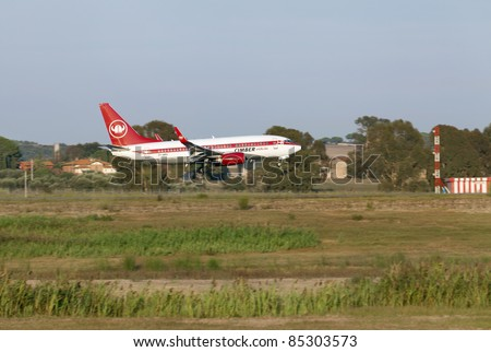 ROME, ITALY - SEPT 16: A Cimber Sertling airplane lands at the airport in Rome, Italy on Sept, 16 2011. The Danish airline operates domestic and international services in co-operation with Scandinavian Airlines.