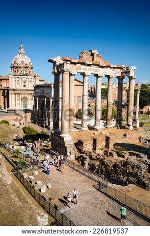 ROME, ITALY - 26 SEPTEMBER 2014. Tourists visiting Roman Forum, Ancient Rome civic center of empire capital, landmark of modern Italy and world heritage.