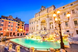 Rome, Italy. Stunningly ornate Trevi Fountain, built in, illuminated at night in the heart of Roma.