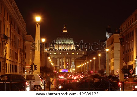 """ROME - JAN 6: traffic in front of  Saint Peter's Dome at night during """"adoration of the Magi"""" celebration on  january 6, 2012 in Rome, Vatican City"""