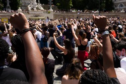 Rome - June 22, 2020: against racism and the killing of Geoge Floyd. The participants remained on their knees and with a high fist for 8'46 '' the time that the Minneapolis policeman kept Floyd stuck