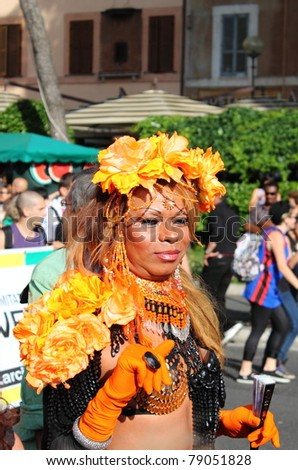 ROME – JUNE 11: An unidentified man in face paint and flowers marches at the Rome Euro Pride Parade, on June 11, 2011 in Rome, Italy