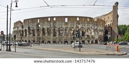 ROME - JUNE 5: the Colosseum on June 5, 2013 in Rome, Italy. The Colosseum is the largest amphitheatre in the world and a major tourist attraction.