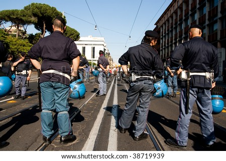 ROME - MAY 30: anti G8 manifestation in Rome city center before G8 meeting in L'Aquila. Policemans are looking the mass coming in May 30, 2009 in Rome, Italy.