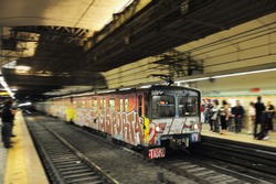Rome Metro (Metropolitana di Roma Metro system) underground train pulls into a station covered in graffiti in Rome, Italy. It started operation in 1955, making it the oldest in the country.