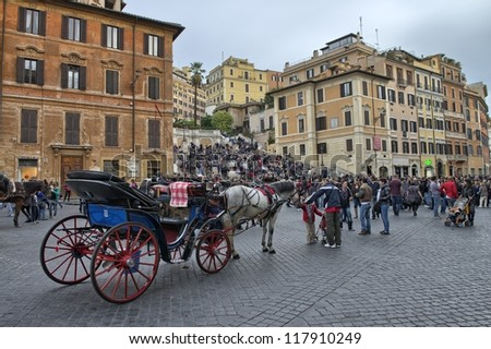 ROME - NOV 3: Carriage awaits customers in Piazza di Spagna, November 3, 2012 in Rome. With its characteristic butterfly plan, the Piazza di Spagna is one of the most famous images in the world.